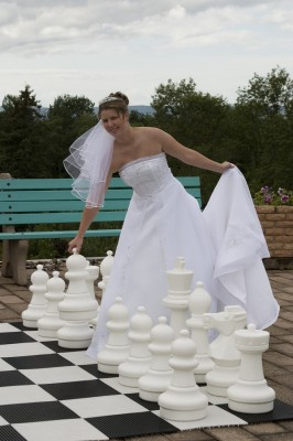 Bride playing large chess game