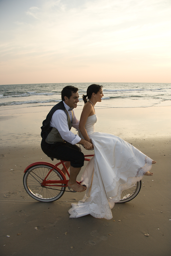 Bride and Groom riding a bike