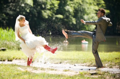 Bride and Groom splashing in puddle