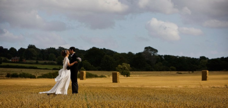 Wedding Couple In Hay Field - via Jonathan Day (flickr.com)