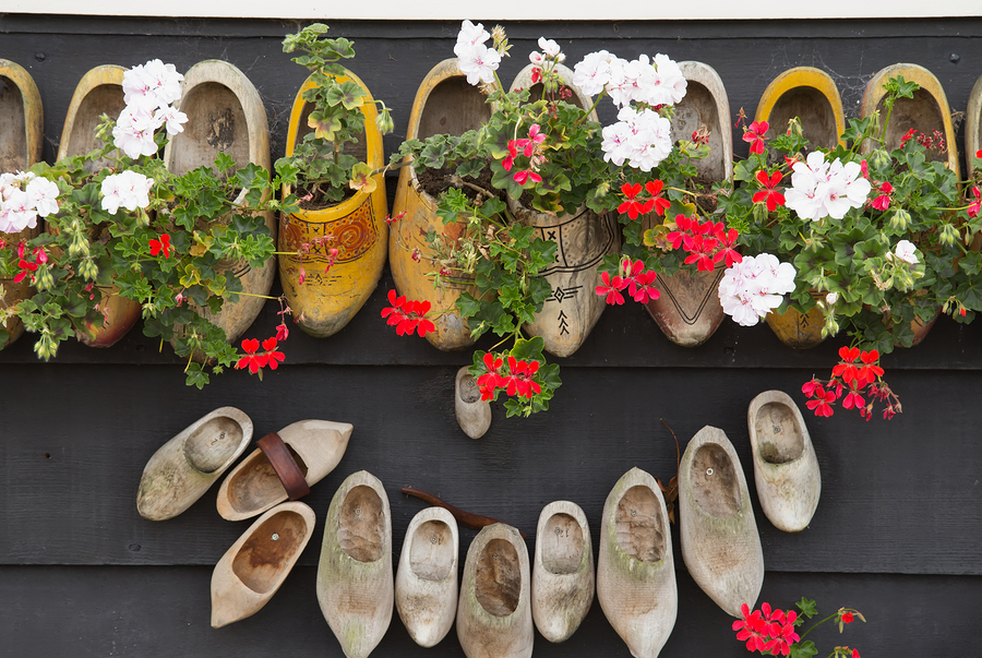 Clogs hanging on wooden wall