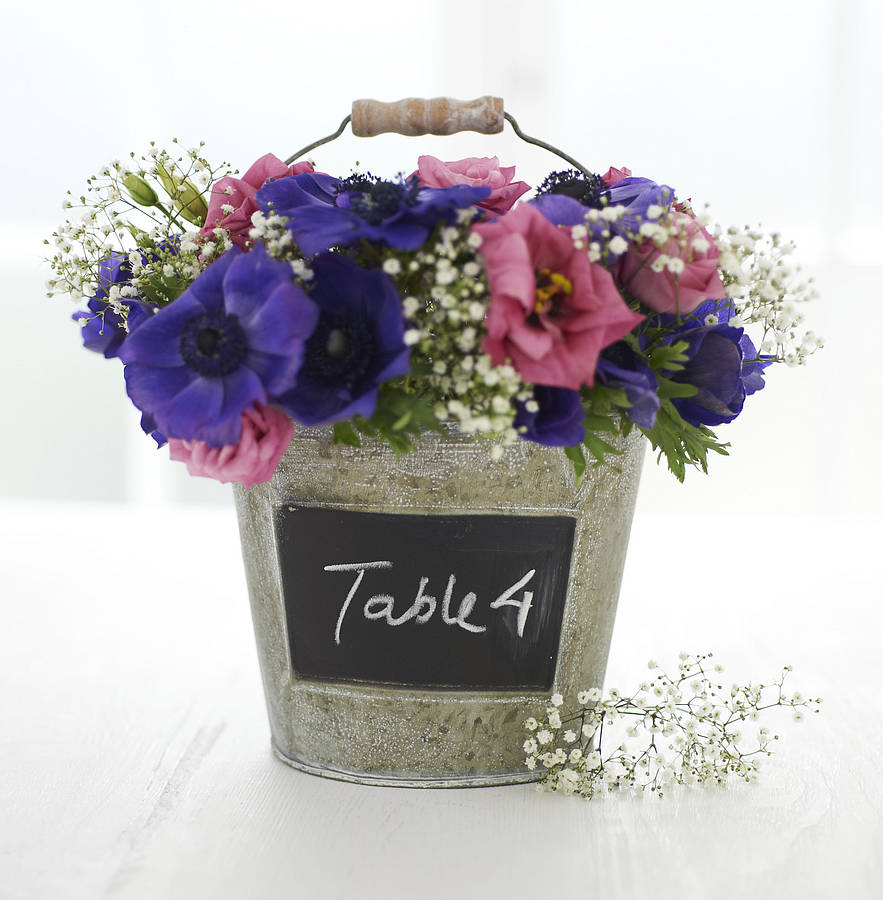 Summer flowers in bucket table number - notonthehighstreet.com