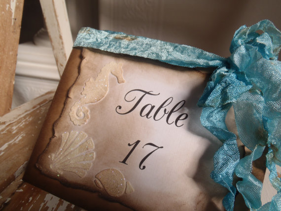 Beach themed aquamarine table number - etsy.com