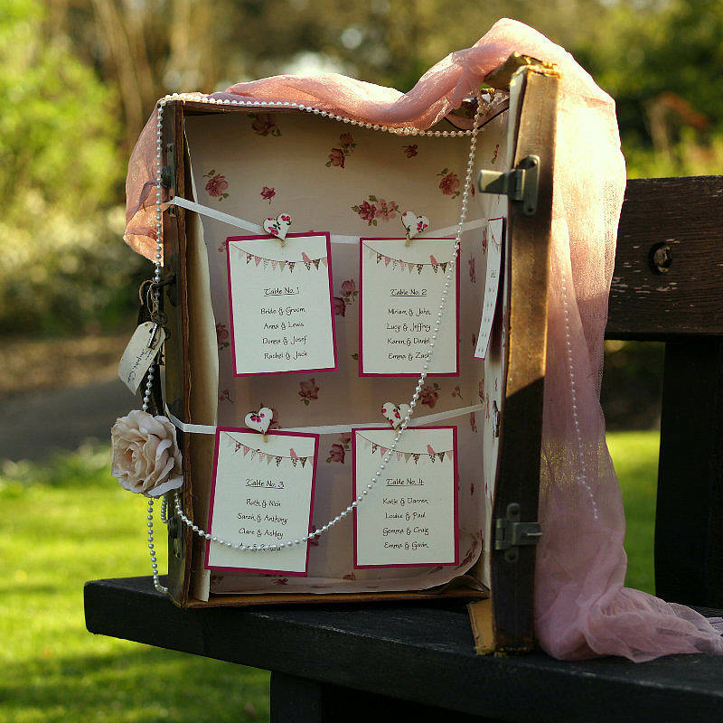 Suitcase table plan cards - notonthehighstreet.com